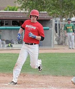 Lovell Mustang Beau Green crosses home plate during a game against the Riverton Raiders in Cowley May 14. David Peck photo