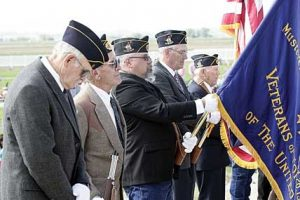 """The local color guard members (l-r) Terry Wilkerson, Butch Fink, Jim Woody, Jack Nicholls and Frank Wilkerson bow their heads during a rendition of """"taps"""" played during a Memorial Day service held at the Cowley Cemetery on Monday. Patti Carpenter photo"""