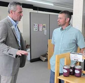 Wyoming Secretary of State Ed Murray paid a visit to the Queen Bee Gardens honey candy story on Main Street in Lovell during his tour of North Big Horn County on Friday, June 10. Here, he visits with Queen Bee's Ben Zeller, who sold Murray several bags of his favorite candy. David Peck photo