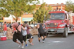 The Better Body Fitness Strongman Competition kicked off Mustang Days Tuesday evening with various events to test each of the competitor's strength. Pictured here competing in the team fire truck pull are (l-r) Chad Lindsay, CJ Lindsay, Michael Montanez, AJ Montanez and Tyler Anderson. They placed first in the truck pull with a time of 57:37 seconds.   Karlie Voss photo