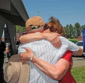 Many old friends saw each other for the first time in years during the Western Sugar Cooperative factory centennial celebration Thursday at Constitution Park. Here, Sheila Hansen hugs former plant manager Dan Lesser during the event. David Peck photo