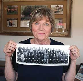 "Sandra Wallace Janzen displays a photo of the Great Western Sugar Co. factory crew taken during the early 1960s in which her grandfather, John Hatch ""Jack"" Asay and his brother Joseph Asay (l-r) are pictured. Both were longtime employees of the sugar company."