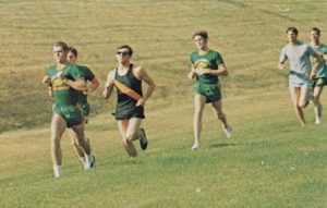 Joe White (in front) strides along a cross country course during his running   career at Rocky Mountain College in 1969. Courtesy photo