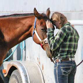 Dacean Thomas enjoys a moment with her horse Angel, a 23-year-old mare who she had ridden most of her life. Courtesy Photo