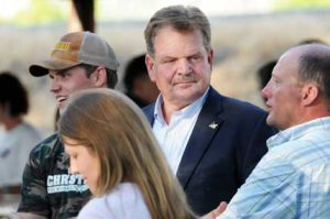 U.S. House of Representatives candidate Leland Christensen (center) and his son Hunter (left) chat with  voters during the Big Horn Republican Party Meet the Candidates forum in Greybull last Tuesday, July 26. Lisa Kunzel photo