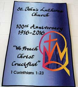Irene Lely's handcrafted banner hangs in St. John's Lutheran Church commemorating the 100-year anniversary of the congregation in Lovell. Patti Carpenter photo