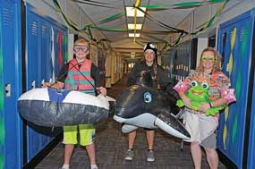 Homecoming activities are ongoing this week at both local high schools. Here, Lovell High School students (left and center) Dallas Oliver and Mylee McArthur, along with math teacher Jeny Gardner, pose on Flotation Device Day Wednesday. David Peck photo