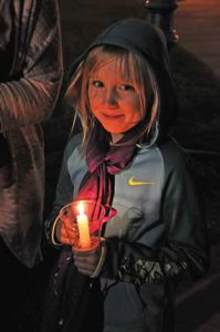 Lovell third-grader Payton Bischoff participates in the CARES candlelight vigil last Tuesday evening at Veterans Park in Lovell. David Peck photo
