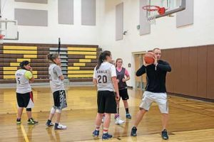 Naomi Alcala, Pepper Lewis, Marissa Arnold and Teagan Townsend gets some pointers from Coach Eric Honeyman during girls basketball practice on Tuesday afternoon at Rocky Mountain High School. Patti Carpenter photo