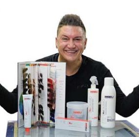 Max Eli Thompson displays his new line of Eli Colour products during a recent visit to Lovell.